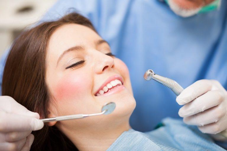 Woman receiving a dental treatment