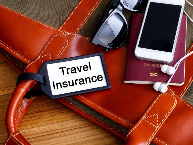 Travel insurance tag on travel bag