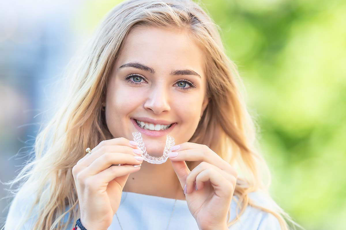 Teenager with invisalign treatment