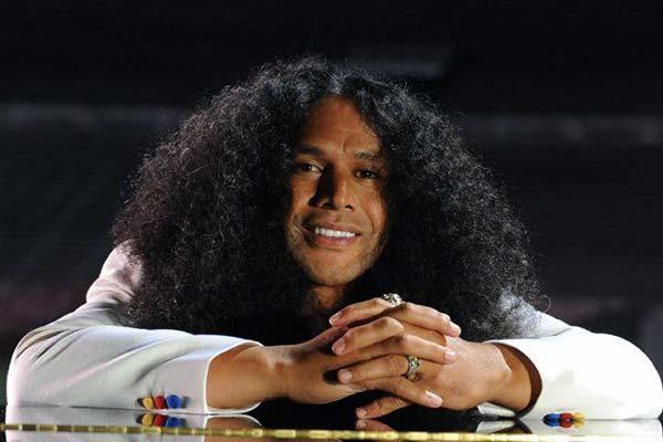 Troy Polamalu insured hair